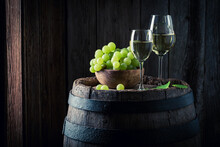 White Wine With Green Grapes On Barrel. Wine Industry.