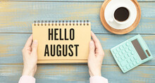 Hello August On Notebook With Morning Cup Of Coffee