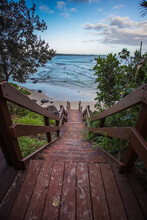 Long Wooden Staircase Leading To The Beach