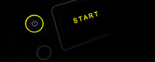 Close Up Of Yellow Power Button, Start Up Business Concept, Black Banner Background