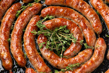 Homemade Pork Sausages In Rustic Pan With Thyme