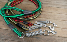 Pet Leashes For Dog Or Cat On Wooden Table.