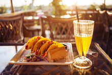 Tacos With Paneer Cheese And Chicken, Cold Kombucha Tea With Straw Served In  Cafe On A Bamboo Table