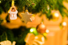 Decorated Christmas Tree, Gold Star Decoration, Selective Focus, Artistic Creamy Bokeh Background.