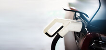 Electric Car Charger. Automotive Technology Of The Future. Save Energy And Protect The Environment.