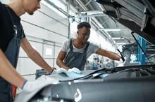 Two Male Mechanics Inspects Engine, Car Service