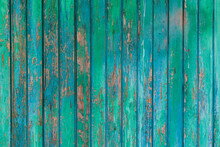 Background Photo Of Panels With Painted Boards With Traces Of Old Paint. A Beautiful Combination Of Turquoise, Blue And Natural Wood.