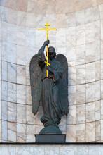 Bronze Statue Of An Angel Holding A Golden Cross