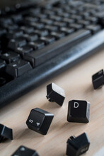 Computer Keys Next To The Keyboard