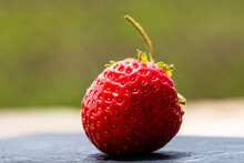 Selective Focus Shot Of A Fresh Strawberry With Visible Seeds Achenes
