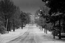 View Of The Winter Street Of One Of Settlements Of Leningrad Region, Russia. Black And White Photo.