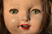 Closeup Of A Creepy Old Doll Face