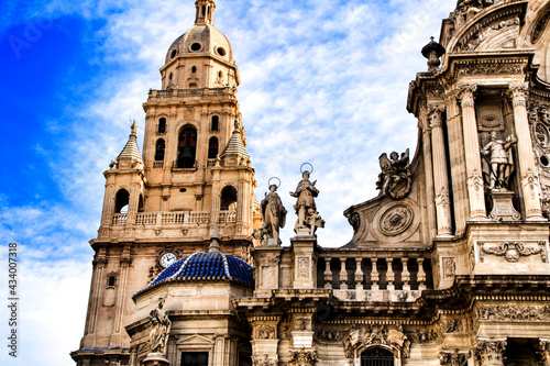 Tower bell, sculptures and carved stone details of the Cathedral of Murcia