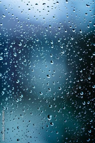 Fotografiet rainy days, rain drops on the window surface