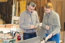 Carpentry Supervisor Getting Data From The Female Carpenter