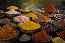 Spices And Herbs Selection On Wooden Background
