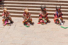 Dancers With Traditional Costumes And Masks During A Religious Performance In The Ancient Kumbum Monastery In The Vicinity Of Xining, Qinghai, China