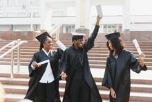 Optimistic Young University Graduates At Graduation