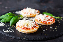 Mini Pizzas With Sausages And Cheese