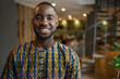 Portrait smiling black african businessman wearing traditional clothing