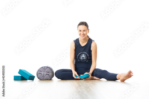 Restorative yoga with a bolster Fotobehang