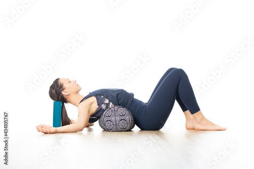Foto Restorative yoga with a bolster