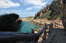 Beautiful View Of Stairs On A Rocky Cliff At Cala Li Cossi Beach In Italy