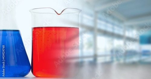 Composition of flask and beaker in lab with motion blur