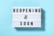 Reopening Soon Light Box With Text Blue Background