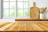 Fototapeta Kawa jest smaczna - Wooden desk of free space and kitchen interior with window
