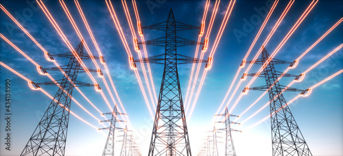 Obraz na plátně Electricity transmission towers with glowing wires against blue sky - Energy con
