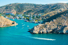 Balaklava Bay Summer In Sunny Weather. Crimea, Russia. Genoese Fortress Chembalo. A Lot Of Boats And Ships. Mountains