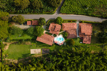 Aerial Top View Of Contemporary Hotel Houses With Outdoor Swimming Pool Surrounded By Verdant Tropical Greenery In Armenia Colombia