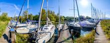 Sailboats At A Jetty