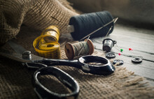 Needle And Thread, Scissors, Sewing Machine. Tailor's, Fashion Designer's, And Seamstress's Tools. Retro Sewing Tools