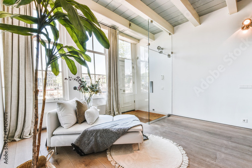 Interior of spacious living room with comfortable chaise lounge located near pla Fototapeta