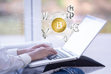 Woman Using Laptop Searching For The Digital World Of The World Currency Market, Currency, Financial And Business Concept.