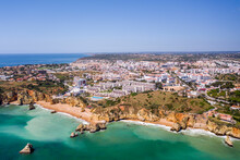 Dona Ana Beach In Lagos, Algarve - Portugal. Portuguese Southern Golden Coast Cliffs. Aerial View With City In The Background. Camilo And Pinhao Beach.