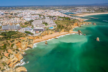 Dona Ana Beach In Lagos, Algarve - Portugal. Portuguese Southern Golden Coast Cliffs. Aerial View With City In The Background