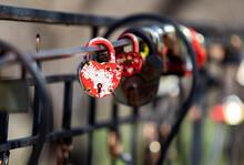 Old Locks Of Love On A Metal Lattice