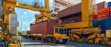 Crane Loading Container Box To Container Cargo Freight Ship In Port Shipping Containers A Logistics Business And Global Trading. Logistics, Global Business And Transportation Concept