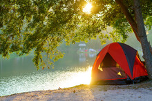 Tourist Tent In Camping Among Meadow In The Mountain Near Lake At National Park