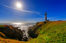 Artistic Sun Flare And Waves Crashing On The Shore By Pigeon Point Lighthouse On Northern California Pacific Ocean Coastline Near Pescadero