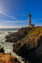 Waves Crashing On The Shore By Pigeon Point Lighthouse On Northern California Pacific Ocean Coastline Near Pescadero