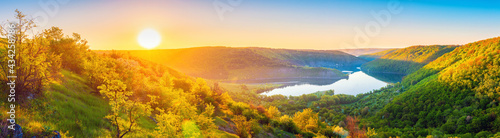 Vivid sunrise landscape in the national nature park Podilski Tovtry, canyon and Studenytsia river is tributary of Dnister river, view from above