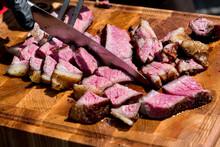 Chef Slicing Tender Medium Rare Roast Beef Brisket