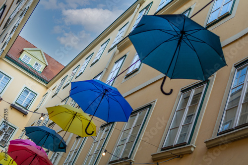 Slika na platnu Umbrellas with different colors hanging in the  Courtyard and public passage Sue