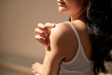 Young Skin Care Woman Applying Body Lotion On Arm And Shoulder At Home