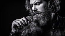 Male Attends Karaoke. Man With A Beard Holding A Microphone And Singing. Man Singing With Microphone. Male Singing With A Microphones. Bearded Man In Karaoke Sings A Song Into A Microphone