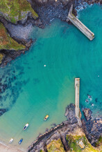 Aerial View Of Few Boats Anchored At Port Isaac Harbour At Sunset, Cornwall, United Kingdom.